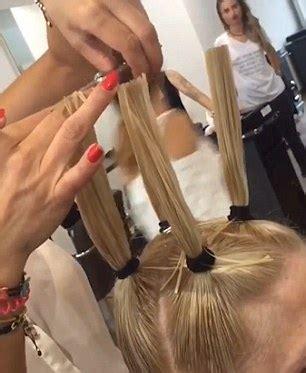 section hair salon hairdresser at m m friseure salon pulls woman s locks into