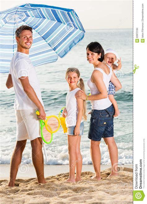 Family Nsun family standing sun umbrella stock photo image