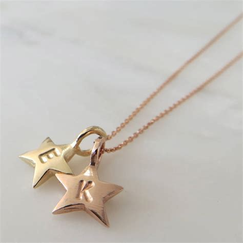 gold baby necklace by gracie collins