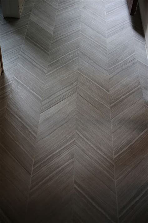 chevron floor tile chevron tile floor master bath home is where