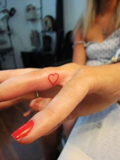 nice tattoo on finger 45 amazing heart tattoo design for finger golfian com