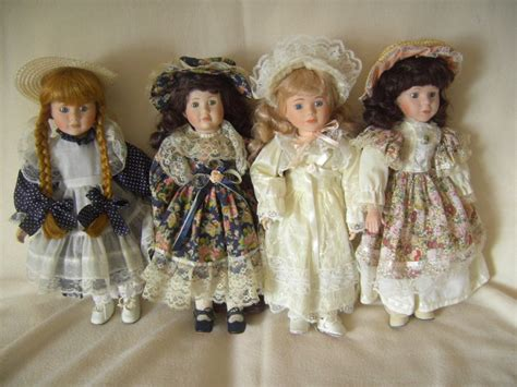Handmade Porcelain Dolls - lot with 4 handmade porcelain dolls the promenade