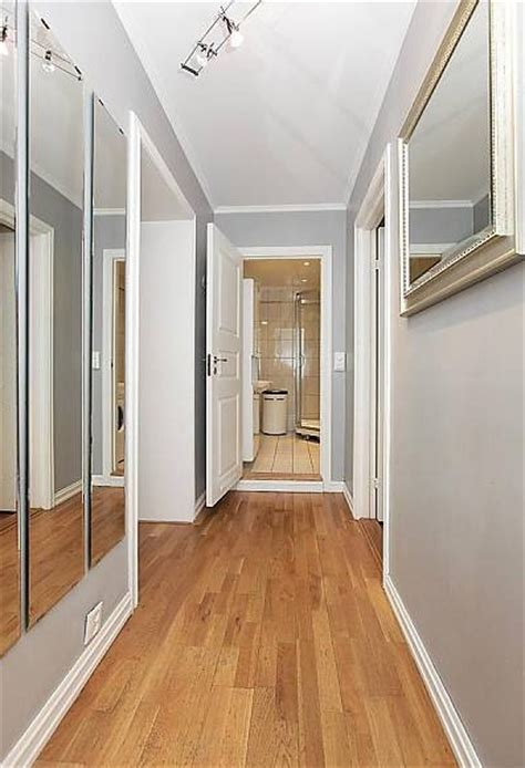 how to make narrow face look wider corridors ugh but clean lines mirrors creating illusion