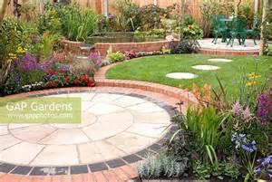 circular patio seating gap gardens small back garden with colourful borders