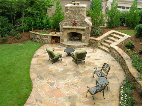 Garden Patio Design After A Beautiful Patio And Fireplace Backed By Plantings That Will Soon Provide Privacy