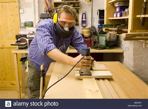 What Is Cabinet Maker by A Cabinet Maker Uses A Router With A Custom Made Jig To