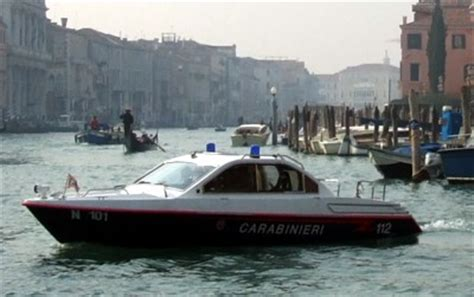italian fire boat boats in venice ambulances hearses delivery barges