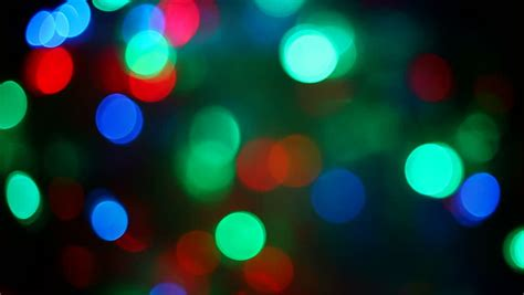 colorful garland lights are sparkling on the background