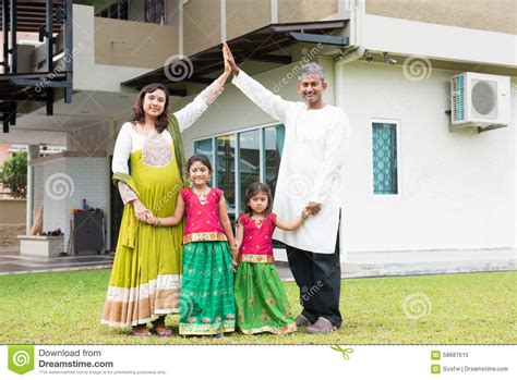 Mother Daughter House Plans by Asian Indian Family Outside Their New Home Stock Photo