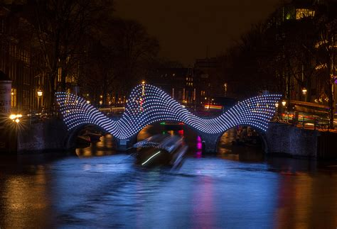 designboom ghost ship tjep illuminates amsterdam s canals with undulating light
