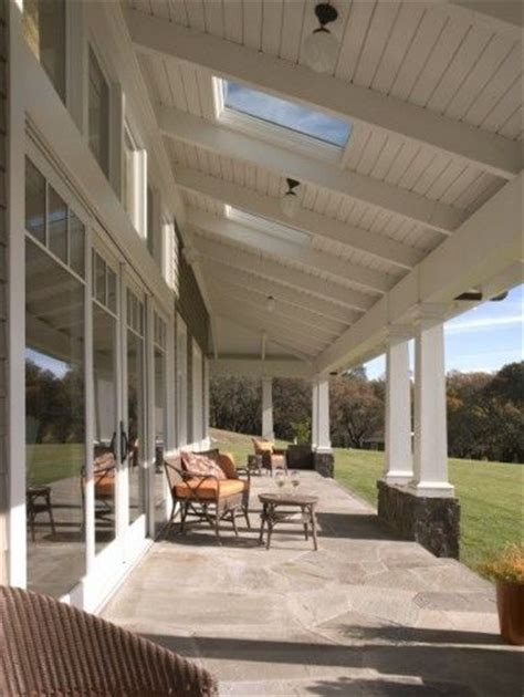 transom windows and skylights in ceiling of covered deck