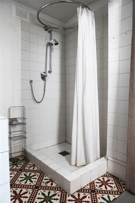 photo hockey floor tiles images shower curtain ideas x for tall shower floor tile larger curtain rod studio bathroom