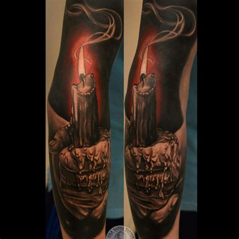 hand holding burning candle tattoo tattoo geek ideas