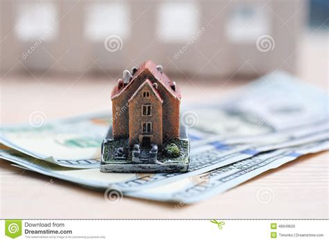 how many pesos to buy a house in mexico many dollar banknotes and a house model concept of buying a hou stock photo image