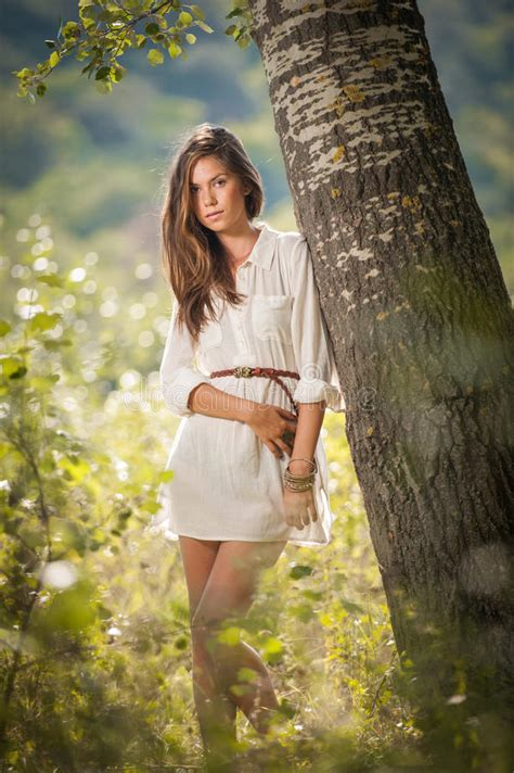 nature cappucino dress by lnd attractive in white dress posing near a