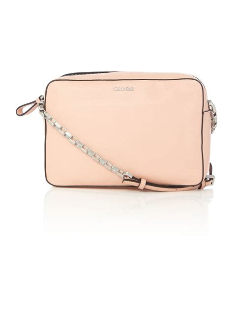 light pink crossbody purse calvin klein kate light pink crossbody bag in pink lyst
