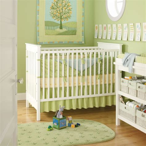 interior white green color baby nursery come with white mirror and brown flooring and