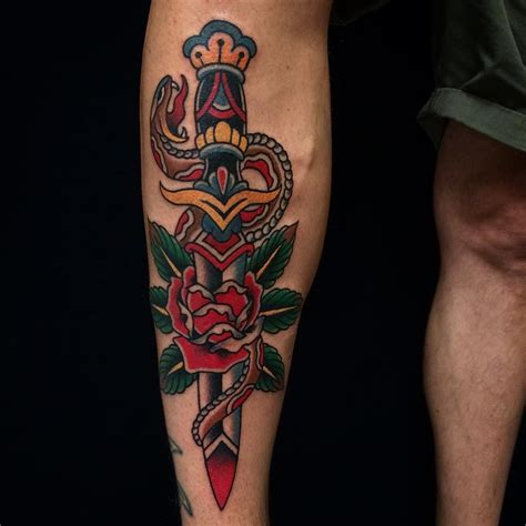 snake tattoo with roses dagger and snake by jens schnettler ink