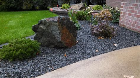 Landscape Edging With Boulders Edging Decorative Rock Mulch Plantings And Boulders
