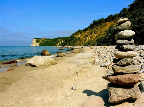 picture beach water sea seashore stone boulder