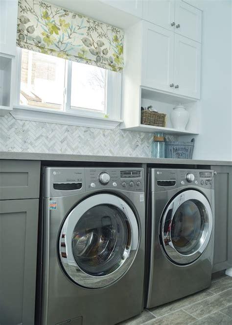 herringbone backsplash transitional laundry room