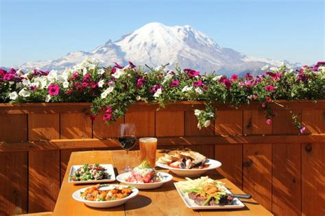 summit house menu outdoor patio surrounded by flowers with a view of mt rainier open during the summer