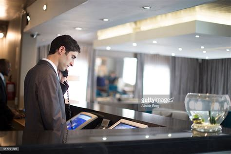 hotel receptionist on phone stock photo getty images