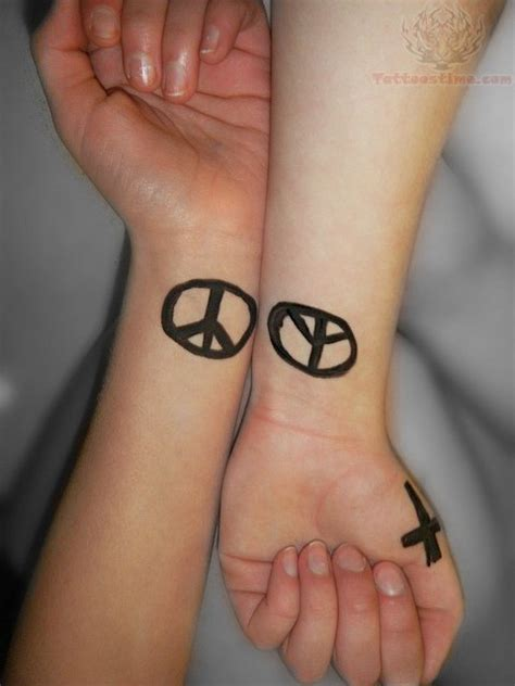 peace sign tattoo on wrist peace symbol tattoos on wrists