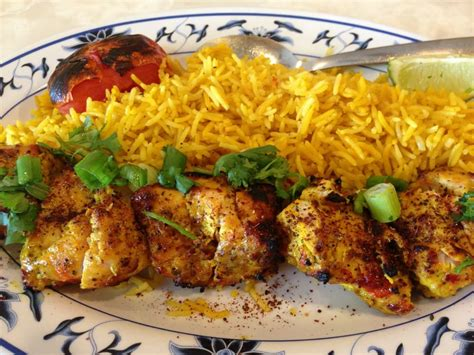 saffron kabob house chicken kebab with saffron rice and grilled tomato yelp