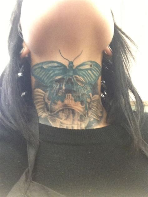 simple blue colored butterfly tattoo on front neck for