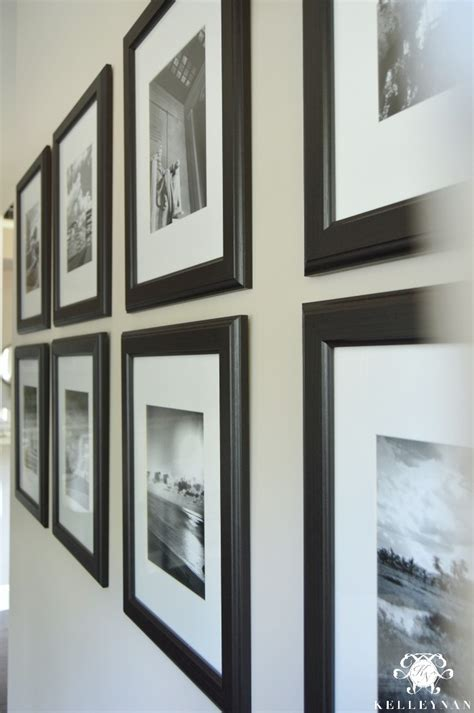 black picture frames with white matting black and white travel gallery wall and other gallery wall