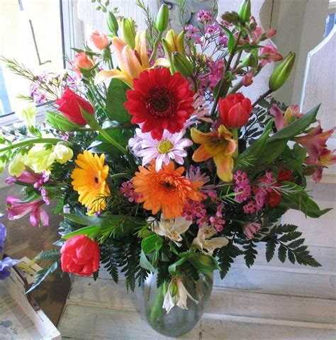 different colored flower arrangements with pretty vase