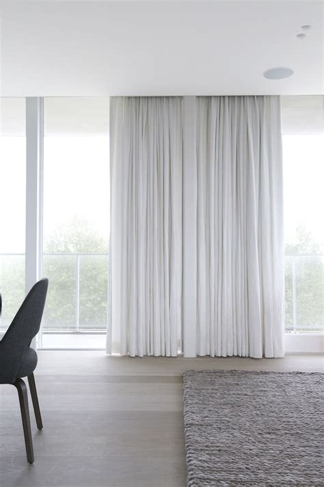 Curtains From Ceiling To Floor Floor To Ceiling Soft Drapes And Oatmeal Woven Carpet For Minimal Understated Bedroom Luxury