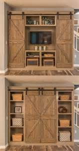 doors that look like bookshelves open the barn doors for an entertainment center and