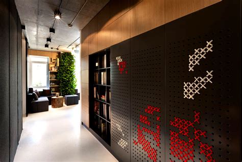 modern office wall integrated green wall at new office of yakusha design