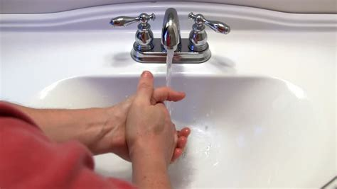 bathroom pov washing of shoo from woman hair close up 4k young