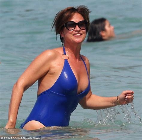 emma forbes shows off her curves in halterneck swimsuit as