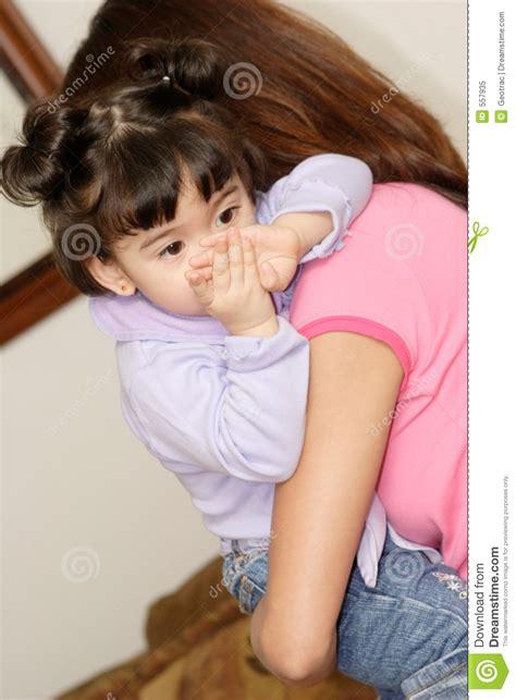 babysitter holding cute baby girl royalty free stock photo