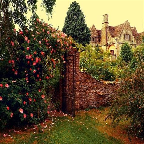 the secret garden cottage beautiful cottage flowers garden gate green image