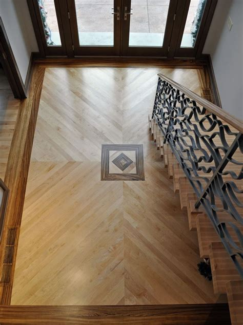 Foyer with Maple plank floor with zebra wood inlay   KAS