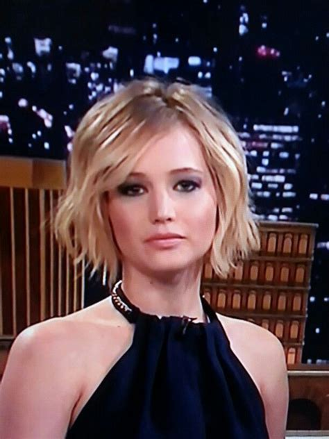 is jennifer lawrence hair cut above ears or just tucked behind jennifer lawrence s cute wavy short bob haircut