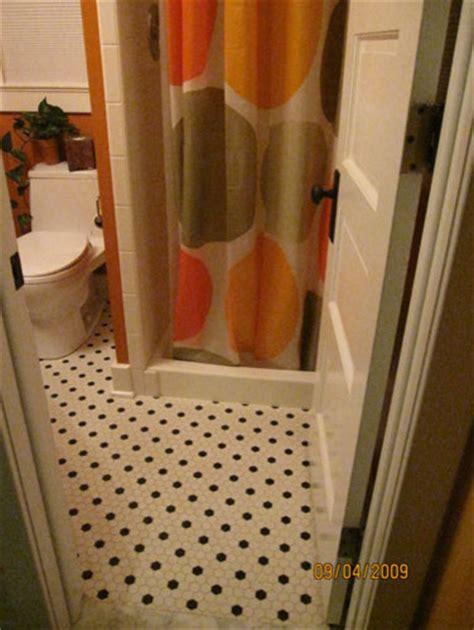 mid century polka dot hex tile bath