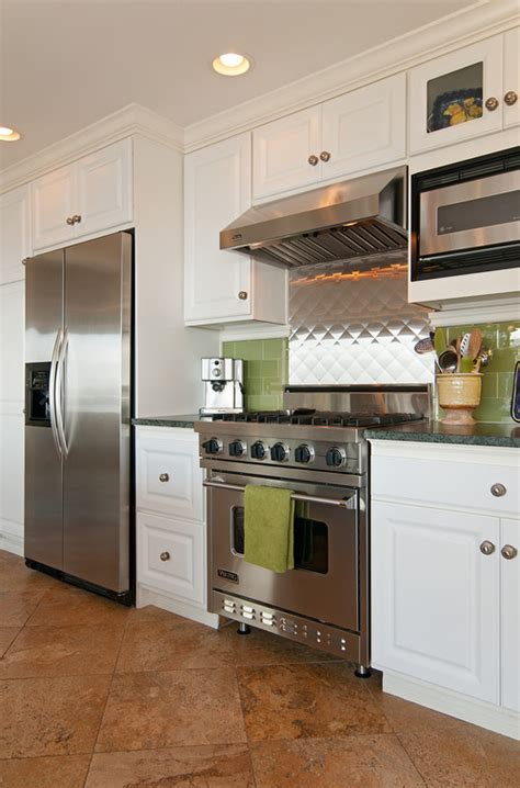 White Kitchen Cabinets With White Granite Countertops by 16 Kitchens That Prove Stainless Steel Can Go Way Beyond