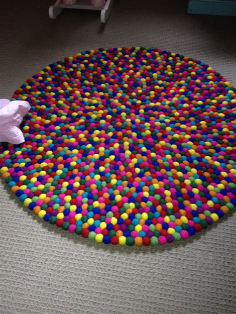 how to make a yarn pom pom rug pom pom rug crafts for my s pom pom rug rugs and