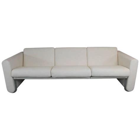 lecorbusier style white sofa with wrap around stainless