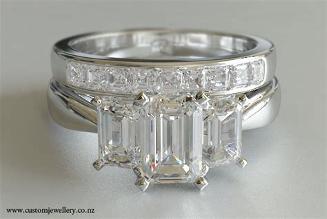 3 emerald cut engagement ring and asscher