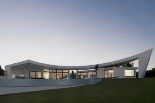 Interior Decorating Tips For Small Homes modern house in curve shape like crescent moon colunata