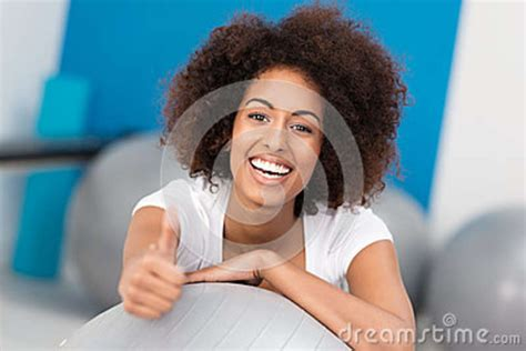hairstyles for african american women working out laughing african american woman in a gym stock photos