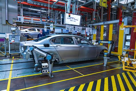 bmw factory bmw shows fancy robots in its factories humans