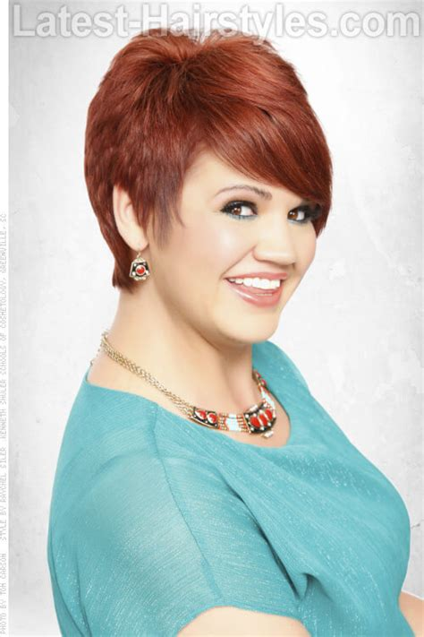 Short Layered Bob With Bangs Hairstyle For Full Figured